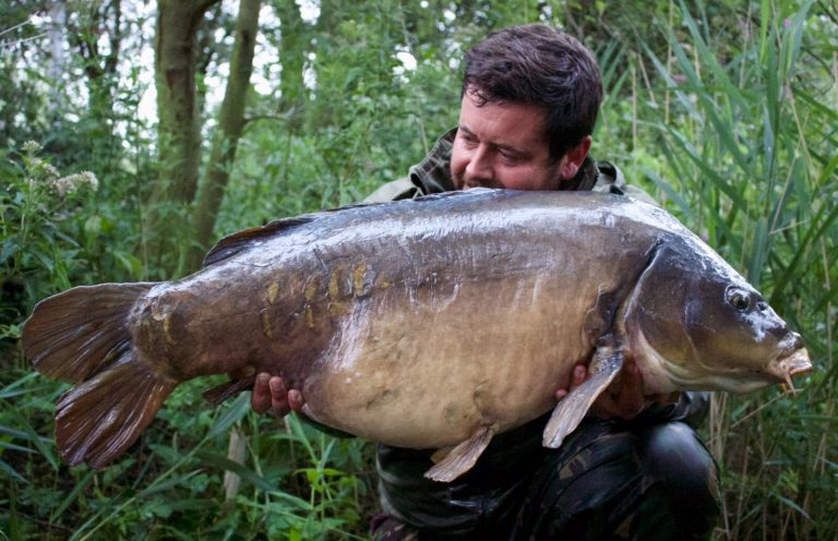 Dan George with one of the biggest mirrors in cambridgeshire
