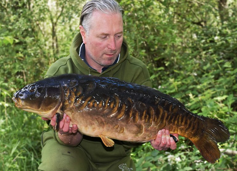 Rob Hardy with an old and rarely caught Lenney that fell to an Amino Ester and tiger nut bait